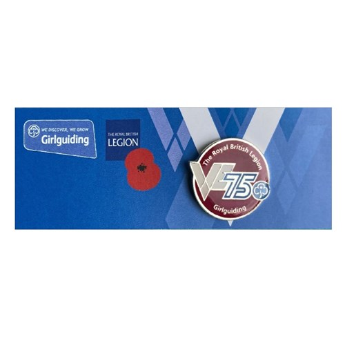 VE 75 metal badge on backing card